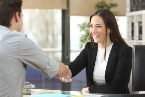 woman shaking a mans hand business deal