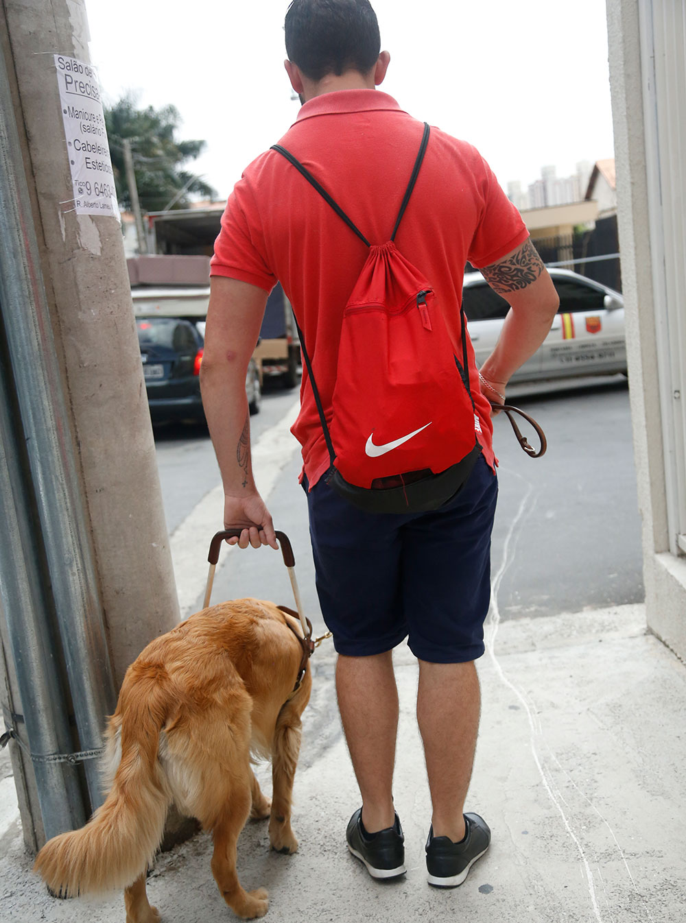 Darley walking with his guide dog, Clark