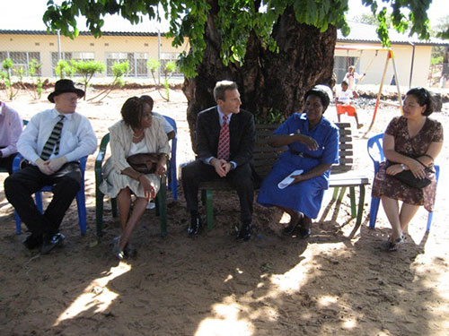 Carmen sitting with the Deputy chief of the mission