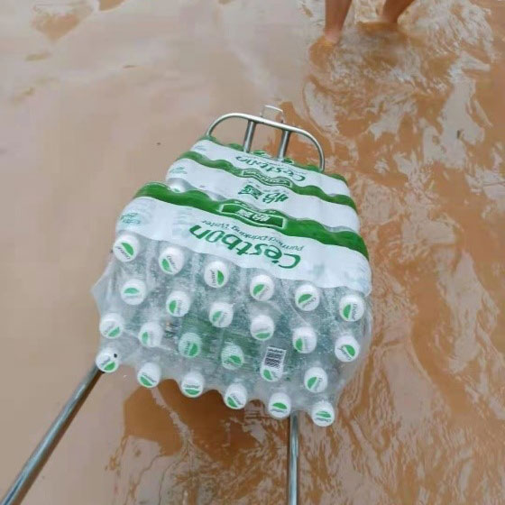transporting cases of water in the flood