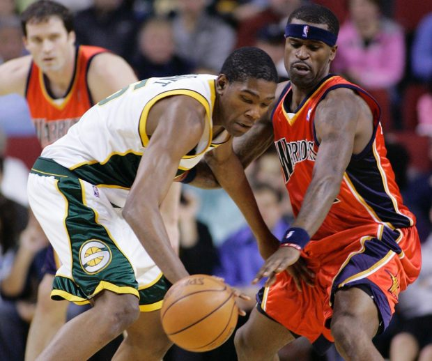 7ad44a447fd Seattle SuperSonics  Kevin Durant has the ball knocked loose by Golden  State Warriors  Al Harrington during the first quarter of an NBA basketball  game in ...