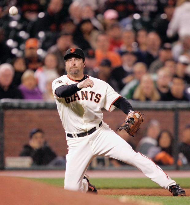 San Francisco Giants third baseman Rich Aurilia throws from his knees to put out Colorado Rockies' Clint Barmes at first base in the sixth inning of a baseball game in San Francisco, Tuesday, Aug. 26, 2008.(AP Photo/Marcio Jose Sanchez)