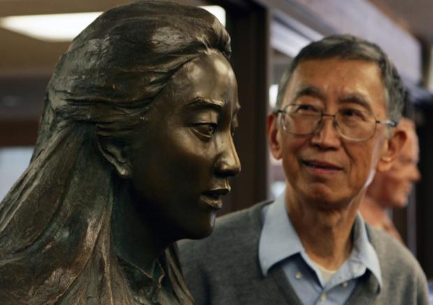 Shau-Jin Chang looks at a bust of his late daughter, Iris Chang, in the archive library at the Hoover Institution at Stanford University.