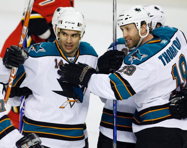 San Jose Sharks' Jonathan Cheechoo, left, celebrates his goal with teammate Joe Thornton during the second period of an NHL hockey game against the Calgary Flames in Calgary, Monday, March 30, 2009. (AP Photo/The Canadian Press, Jeff McIntosh)