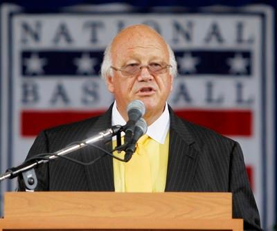 Jon Miller speaks after receiving the Ford C. Frick Award for broadcasting during the Baseball Hall of Fame ceremony in Cooperstown, N.Y., on Sunday, July 25, 2010. (AP Photo/Mike Groll)