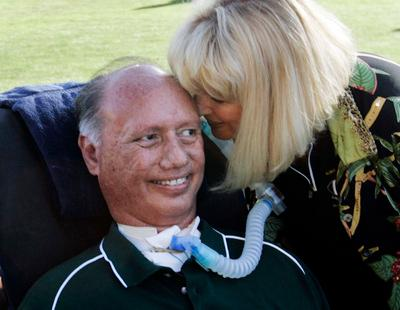 Former Los Gatos High School football coach Charlie Wedemeyer gets a kiss from his wife Lucy at the 32nd annual All Star game held at Spartan Stadium in July 2007. Wedemeyer passed away in June after a 32 year battle with Lou Gehrig's disease. Hundreds of former players and admirers turned out for Wedemeyer's memorial service that was held at HP Pavilion to celebrate his life. (Patrick Tehan/Mercury News)