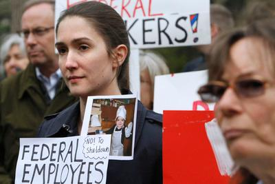 U.S. diplomats and federal workers take part in rally against the prospect of a government shutdown, Friday, April 8, 2011, in Washington. (AP Photo/Jacquelyn Martin)