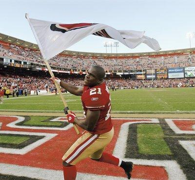 San Francisco 49ers Frank Gore (21) waves a 49ers flag after they beat the St. Louis Rams 26-0 at Candlestick Park in San Francisco, Calif. on Sunday, December 4, 2011. (Nhat V. Meyer/Mercury News)