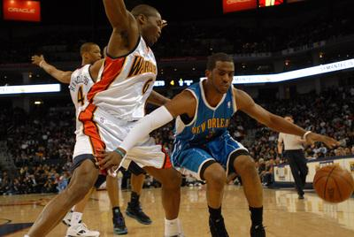 Anthony Randolph (#4) and Jamal Crawford (#6) of the Warriors guard Chris Paul (#3) of the Hornets during their game at Oracle Arena in Oakland, Calif. on Friday, April 3, 2009. (Sherry LaVars/Staff)