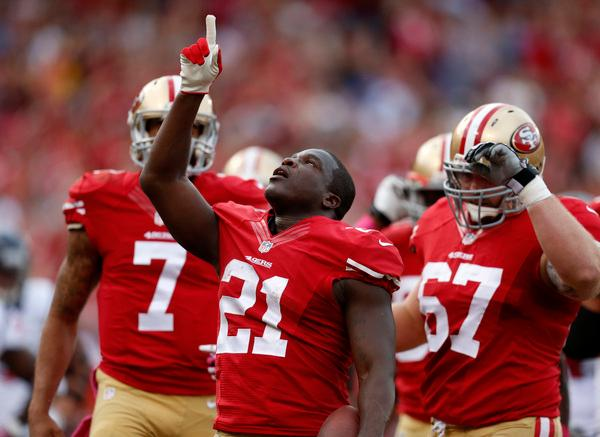 San Francisco 49ers' Frank Gore (21) celebrates his touchdown against the Houston Texans in the first quarter at Candlestick Park in San Francisco, Calif., on Sunday, Oct. 6, 2013. (Nhat V. Meyer/Bay Area News Group)
