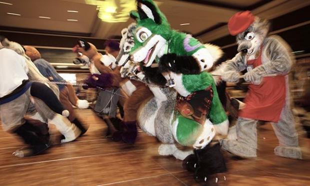 Furry creatures take part in a dog sled race during festivities at the 12th annual Further Confusion convention at the Fairmont Hotel in San Jose on Jan. 24, 2010. FurCon celebrates the anthropomorphics genre with people dressing as furry creatures that have human and animal characteristics. (Gary Reyes/Mercury News)