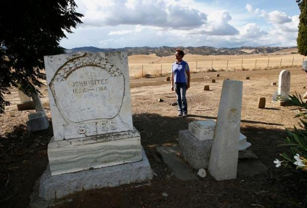 Mary Wells stands in the cemetery on her ranch in Maxwell, Calif., in 2014. In the foreground is the tombstone of John Sites, a pioneering rancher who settled in the area in the 1850s and for whom the community is named. (Gary Reyes/Bay Area News Group)