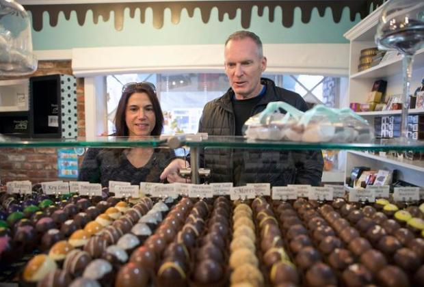 Customers, from right, Michael Shannon and Leslie Shannon of Willow Glen check out the chocolates at Mariette Chocolates in the Willow Glen neighborhood of San Jose, Calif., on Saturday, Nov. 29, 2014. (LiPo Ching/Bay Area News Group)