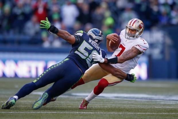 SEATTLE, WA - DECEMBER 14: Quarterback Colin Kaepernick #7 of the San Francisco 49ers is sacked by outside linebacker K.J. Wright #50 of the Seattle Seahawks at CenturyLink Field on December 14, 2014 in Seattle, Washington. (Photo by Otto Greule Jr/Getty Images)