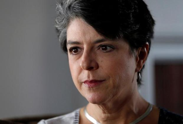 """Jennifer Glass, 51, who was diagnosed with advanced lung cancer last year, just four months after getting married, is photographed at her home in San Mateo, Calif., on Nov. 3, 2014, one day after Brittany Maynard ended her life in Oregon. """"I am at peace with the idea that my life will end,"""" she said. """"What terrifies me is the thought of how it may end if my cancer runs its course."""" (Karl Mondon/Bay Area News Group)"""