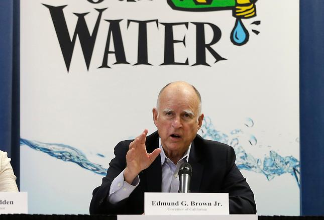 16 2015 Gov. Jerry Brown talks with reporters after a meeting about the drought at his Capitol office in Sacramento Calif. California s Democratic state senators released a letter Thursday