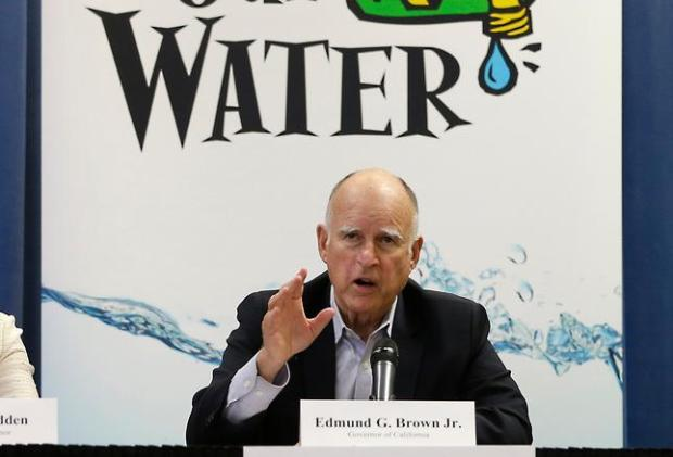 In this photo taken Thursday, April 16, 2015 Gov. Jerry Brown talks with reporters after a meeting about the drought at his Capitol office in Sacramento, Calif. California s Democratic state senators released a letter, Thursday, April 30, 2015, they sent to Brown, earlier in the week, urging the governor s administration to get water savings projects started in months instead of years and calling for farmers to step up conservation in the face of a relentless drought.(AP Photo/Rich Pedroncelli)