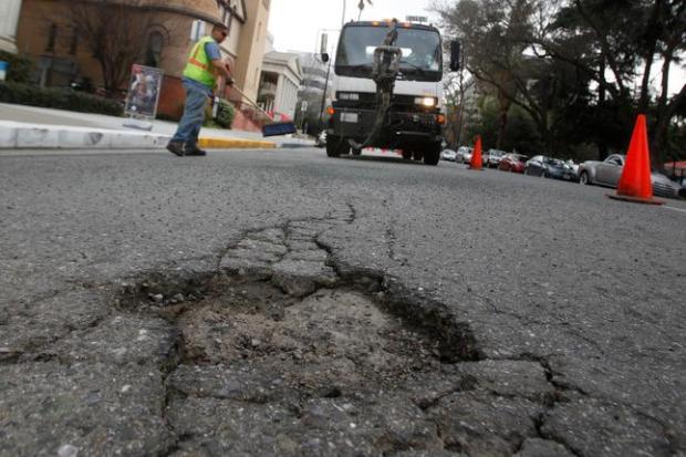 Fixing potholes in downtown San Jose. (Mercury News archives)