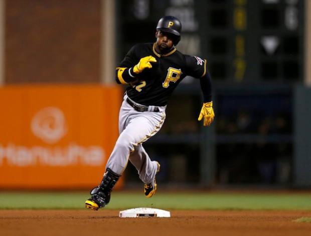 Pittsburgh Pirates' Andrew McCutchen (22) rounds second base on his way to third for a triple during their game against the San Francisco Giants in the fourth inning at AT&T Park in San Francisco, Calif, on Tuesday, June 2, 2015. (Nhat V. Meyer/Bay Area News Group)