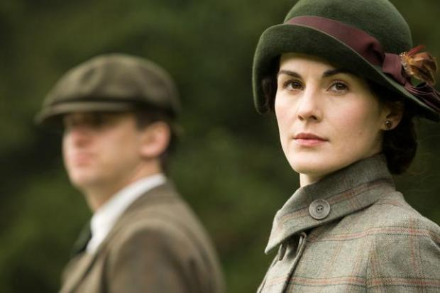 """FILE - In this file photo released by PBS, Dan Stevens as Matthew Crawley, left, and Michelle Dockery as Lady Mary are shown in a scene from the second season on """"Downton Abbey."""" The program was nominated for an Emmy award for outstanding drama series on Thursday, July 19, 2012. The 64th annual Primetime Emmy Awards will be presented Sept. 23 at the Nokia Theatre in Los Angeles, hosted by Jimmy Kimmel and airing live on ABC. (AP Photo/PBS, Carnival Film & Television Limited 2011 for MASTERPIECE, File)"""