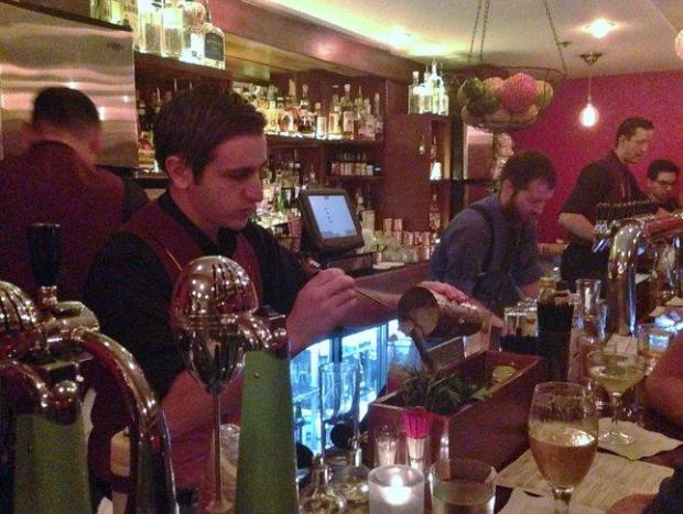 A team of bartenders create craft cocktails behind the bar at Haberdasherin downtown San Jose on Saturday, Aug. 22, 2015. (Sal Pizarro/Staff)
