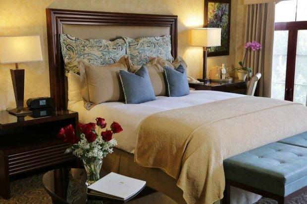 Guest rooms at the Vintners Inn in Santa Rosa feature private balconies or patios and king-size beds topped with plumped comforters and luxury linens.