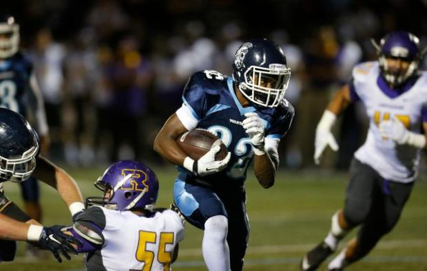 Valley Christian's Javon Sturns runs for a touchdown against Archbishop Riordan in the first quarter at Valley Christian High School in San Jose, Calif., on Friday, Oct. 30, 2015. (Jim Gensheimer/Bay Area News Group)