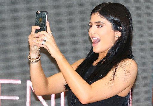 Kylie Jenner takes a selfie as she and sister Kendall arrive at Chadstone Shopping Centre on November 18, 2015 in Melbourne, Australia.