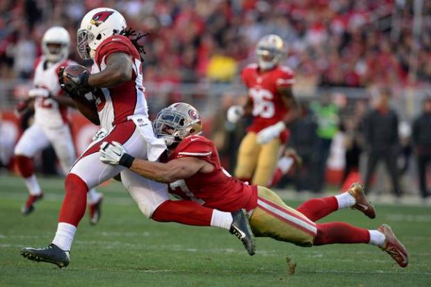 Arizona Cardinals' Robert Hughes (39) gets tackled from behind by San Francisco 49ers' Michael Wilhoite (57) in the fourth quarter of their NFL game at Levi's Stadium in Santa Clara, Calif., on Sunday, Dec. 28, 2014. San Francisco defeated the Arizona Cardinals 20-17. (Jose Carlos Fajardo/Bay Area News Group)