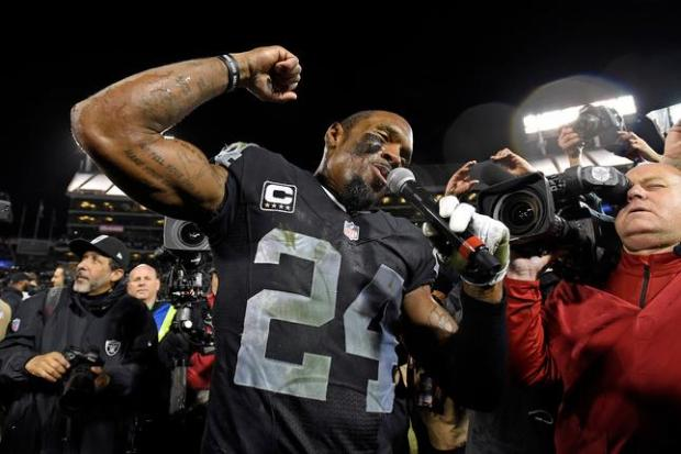Oakland Raider's Charles Woodson (24) speaks to the audience after defeating the San Diego Chargers during their NFL game at O.Co Coliseum in Oakland, Calif., on Thursday, Dec. 24, 2015. Oakland defeated San Diego 23-20 in overtime. (Jose Carlos Fajardo/Bay Area News Group)