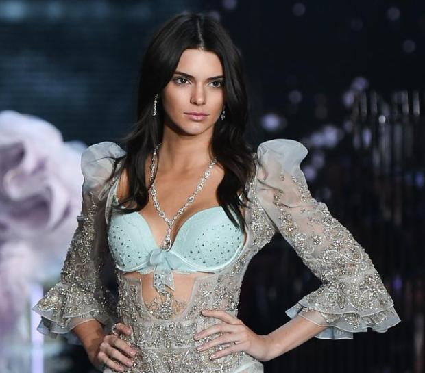 FILE - In this Nov. 10, 2015, file photo, model Kendall Jenner walks the runway during the 2015 Victoria's Secret Fashion Show at the Lexington Armory in New York. An image of model and reality TV star Jenner posing with her hair forming several heart shapes was the year's most liked photo on Instagram. The image has been liked more than 2.3 million times since it was posted in July 2015. (Photo by Evan Agostini/Invision/AP, File)