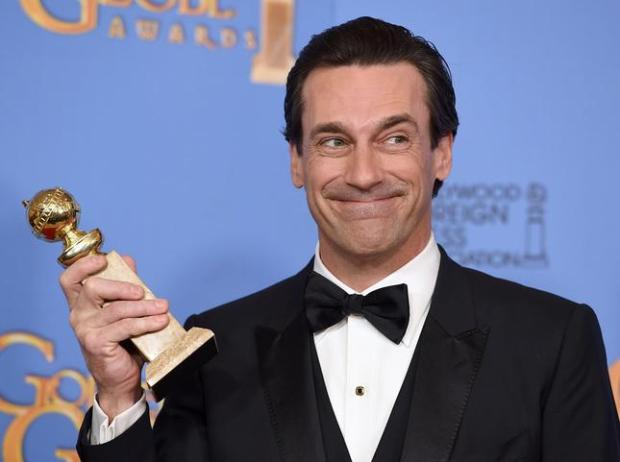 Jon Hamm poses in the press room with the award for best performance by an actor in a TV series - drama for Mad Men at the 73rd annual Golden Globe Awards on Sunday, Jan. 10, 2016, at the Beverly Hilton Hotel in Beverly Hills, Calif. (Photo by Jordan Strauss/Invision/AP)