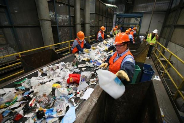 Workers sort items on the material recovery facility line at the Fremont Recycling and Transfer Station on Wednesday, March 9, 2016, in Fremont, Calif. (Aric Crabb/Bay Area News Group)