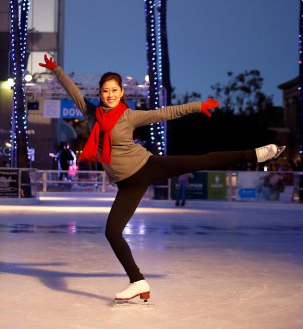 Olympic champion Kristi Yamaguchi poses for the camera as she skates at the opening ceremony at Downtown Ice in San Jose, Calif., on Monday, Nov. 16, 2015. (Josie Lepe/ Bay Area News Group)