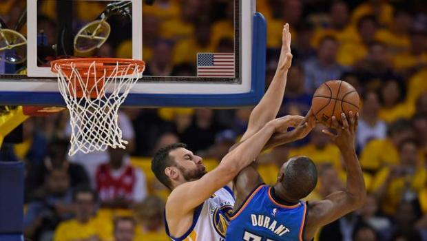 Golden State Warriors' Andrew Bogut (12) guards Oklahoma City Thunder's Kevin Durant (35) in the first quarter of Game 1 of the NBA Western Conference finals at Oracle Arena in Oakland, Calif., on Monday, May 16, 2016. (Jose Carlos Fajardo/Bay Area News Group)