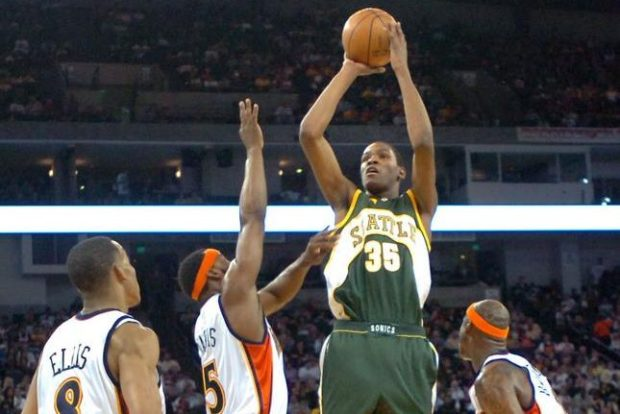 546f3ba46727 FILE — Kevin Durant of the Seattle Supersonics shoots over the Golden State  Warriors  Monta Ellis