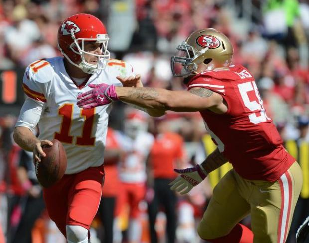 San Francisco 49ers' Aaron Lynch (59) puts pressure on the Kansas City Chiefs' Alex Smith (11) in the first quarter of their NFL game at Levi's Stadium in Santa Clara, Calif., on Sunday, Oct. 5, 2014. (Dan Honda/Bay Area News Group)