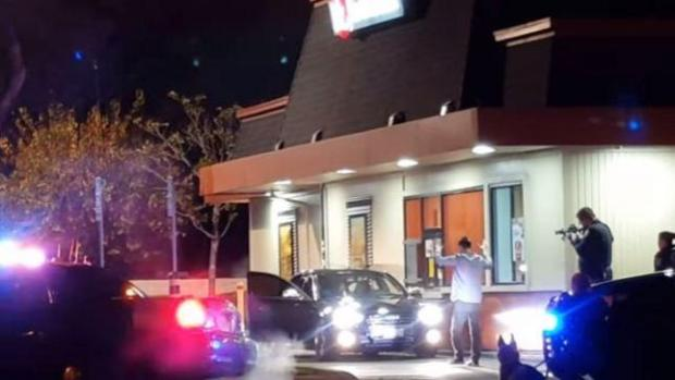 In this witness video, off-duty Santa Clara Co. Sheriff's deputy Benjamin Lee is taken into custody by Santa Clara police after he allegedly was driving under the influence and waved a gun at a Jack in the Box on El Camino Real on Jan. 10, 2016.