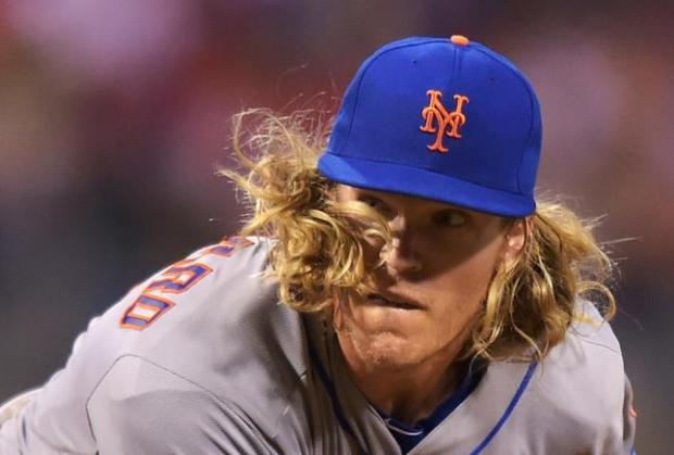 PHILADELPHIA, PA - APRIL 18: Noah Syndergaard #34 of the New York Mets has his hair fly in his face while delivering a pitch in the seventh inning against the Philadelphia Phillies at Citizens Bank Park on April 18, 2016 in Philadelphia, Pennsylvania. The Mets won 5-2. (Photo by Drew Hallowell/Getty Images) ***BESTPIX***