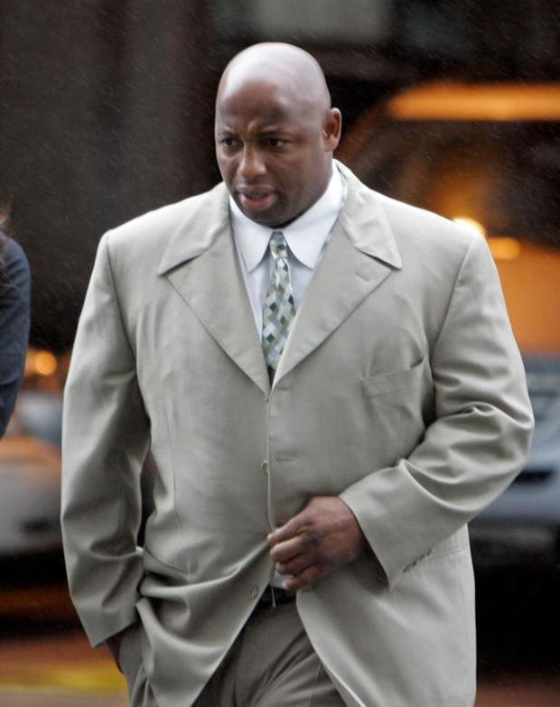 Former National Football League player Dana Stubblefield enters the federal building to attend his sentencing hearing for lying to federal agents investigating steroid use in sports, in San Francisco, Friday, Feb. 6, 2009. Prosecutors have asked a judge to give Stubblefield probation rather than prison time because of his cooperation with investigators.(AP Photo/Eric Risberg)