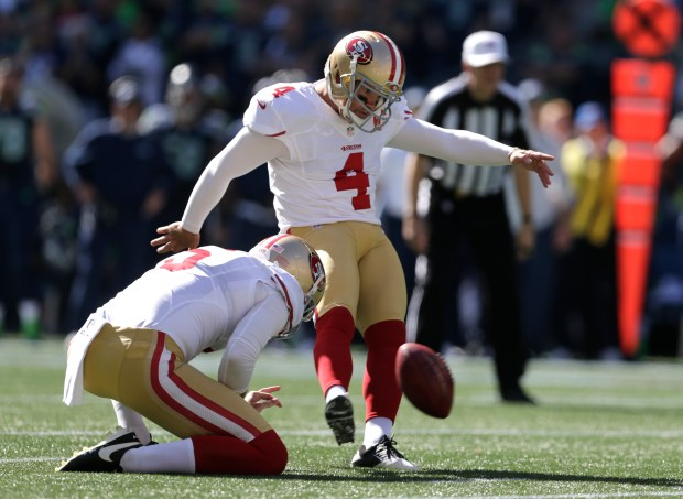 San Francisco 49ers' Phil Dawson (4) kicks a field goal as Bradley Pinion holds the ball against the Seattle Seahawks in the first half of an NFL football game, Sunday, Sept. 25, 2016, in Seattle. (AP Photo/John Froschauer)
