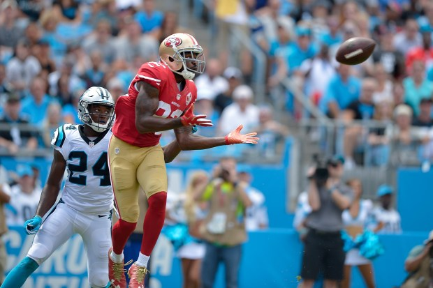 Torrey Smith #82 of the San Francisco 49ers makes a touchdown catch against James Bradberry #24 of the Carolina Panthers during the game at Bank of America Stadium on September 18, 2016 in Charlotte, North Carolina. (Photo by Grant Halverson/Getty Images)