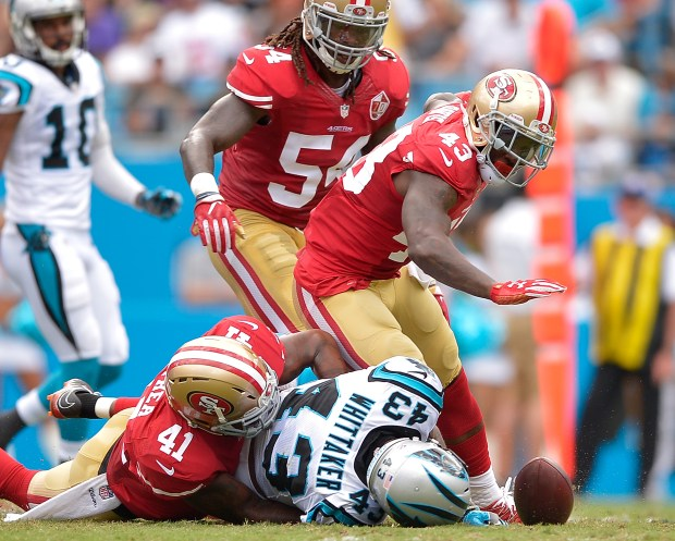 Antoine Bethea #41 of the San Francisco 49ers forces a fumble by Fozzy Whittaker #43 of the Carolina Panthers during the game at Bank of America Stadium on September 18, 2016 in Charlotte, North Carolina. (Photo by Grant Halverson/Getty Images)