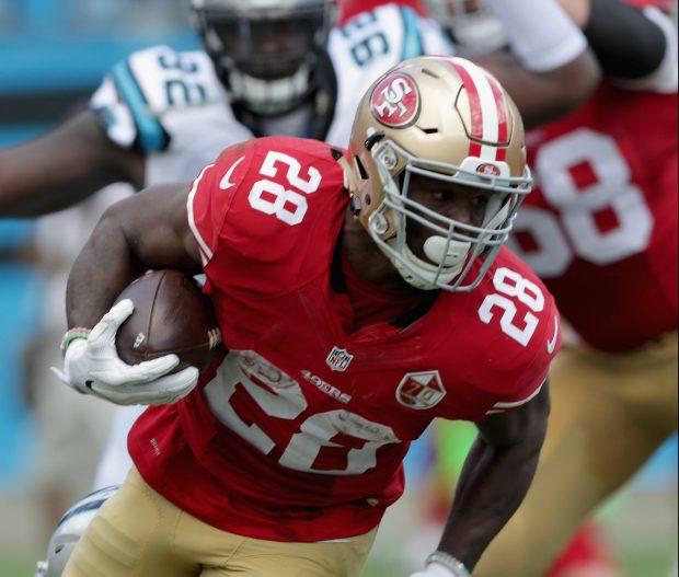 CHARLOTTE, NC - SEPTEMBER 18: Carlos Hyde #28 of the San Francisco 49ers runs the ball against the Carolina Panthers in the 2nd quarter during their game at Bank of America Stadium on September 18, 2016 in Charlotte, North Carolina. (Photo by Streeter Lecka/Getty Images)