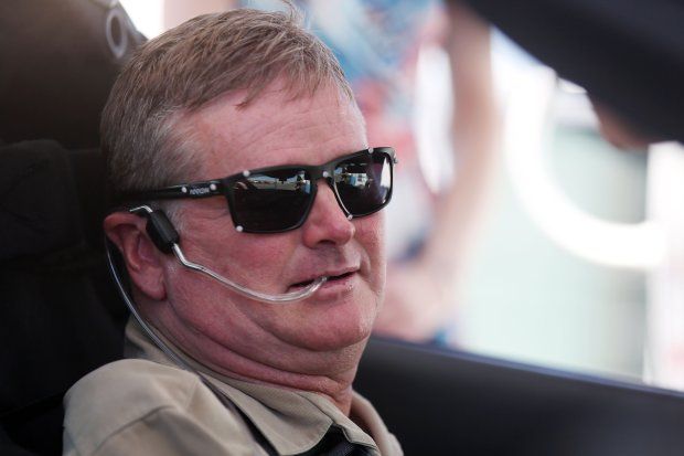 Indy Racing League driver Sam Schmidt prepares to drive his modified Corvette on Tuesday, Sept. 27, 2016, in Las Vegas. Schmidt was paralyzed from the neck down in a crash 16 years ago. His car uses four cameras to monitor his head and transmit his movements to the tires. He breathes into a tube to accelerate and sucks the air out when he wants to brake. (AP Photo/Isaac Brekken)