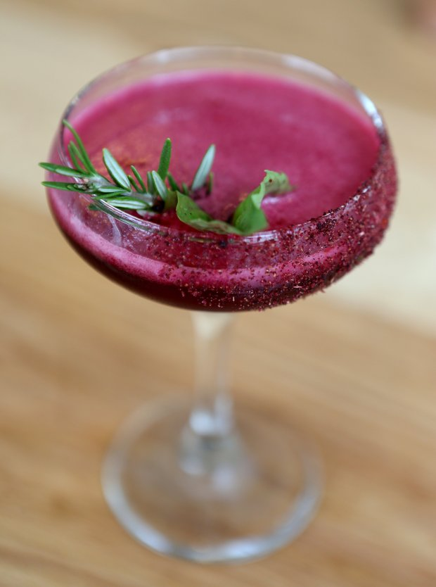 An Uptown Sunset, a mezcal cocktail with hibiscus syrup is photographed at Agave Uptown in Oakland, Calif., on Thursday, Sept. 1,2016. (Anda Chu/Bay Area News Group)