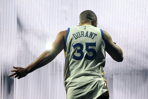 Rapper Drake sports a Warriors' Kevin Durant jersey as he performs in concert during the Summer Sixteen Tour with Future at the Oracle Arena in Oakland, Calif., on Tuesday, Sept. 13, 2016. (Ray Chavez/Bay Area News Group)