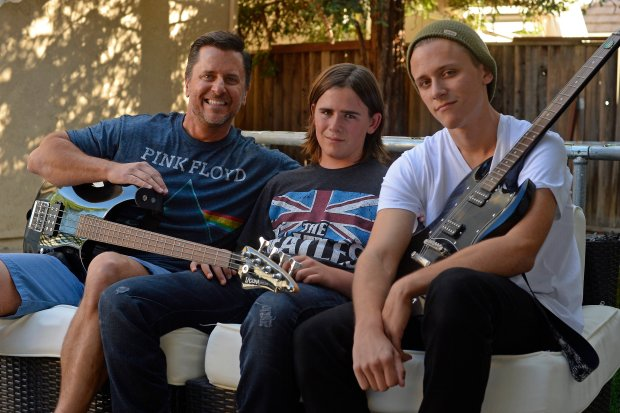 Pat Ireland, 49, of Brentwood, sits with his sons Maddox Ireland, 13, from left, and John Ireland, 17, at their home in Brentwood, Calif., on Friday, Sept. 23, 2016. Ireland is taking his kids to experience the giant Desert Trip classic rock festival in Coachella. (Jose Carlos Fajardo/Bay Area News Group)