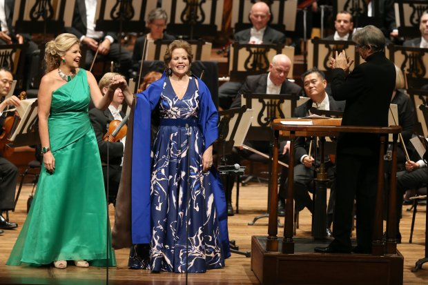 "Mezzo-soprano Susan Graham, left, and soprano Renee Fleming acknowledge the audience as San Francisco Symphony director and conductor Michael Tilson Thomas applauds after singing ""Ah guarda, sorella"" from Mozart's ""Cosi fan tutte"" during the San Francisco Symphony opening night gala at Louise M. Davies Symphony Hall in San Francisco, Calif., on Wednesday, Sept. 7, 2016. (Ray Chavez/Bay Area News Group)"