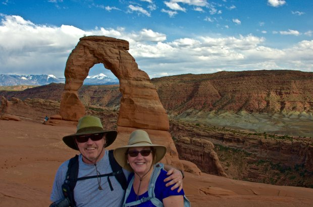 """COURTESY OF THE JENNINGS FAMILY UTAH: Concord residents John and Sonja Jennings visited Arches National Park this summer and hiked to the Delicate Arch, pictured. Travel tips: """"The trail is about 3 miles round trip with a 500-foot elevation gain,"""" John says. """"Be careful though: The trailhead is at 4,300 feet so the hike is literally breathtaking.  Allow 2 to 3 hours to do the hike. If you aren't in shape, you might be a bit sore the next day. Arches National Park is only minutes away from Moab, where you find lots of places to stay and good food."""""""